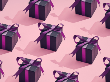 Photo of pink gifts in a row on pink background